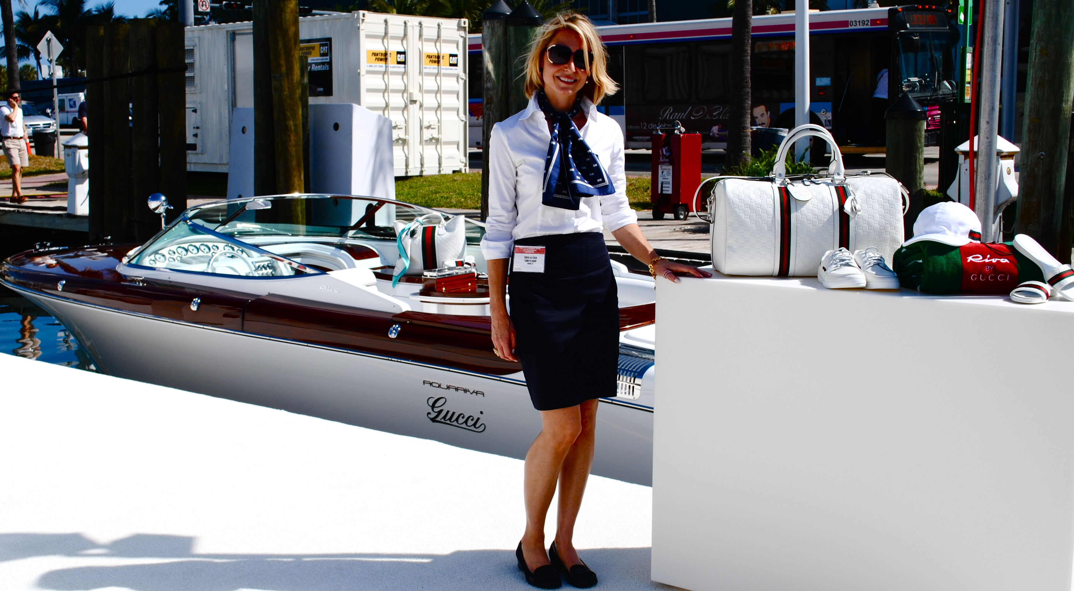 The glossy white Aquariva by Gucci, awash in brilliant Miami sunlight at  the Yacht and Brokerage Show on Collins Avenue in Miami Beach, lures show  goers for ... 06102c4d066