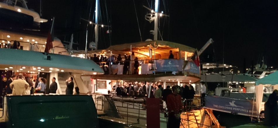 Enjoying entertainment on a yacht at dock at night.