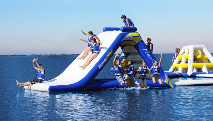 Enjoy inflatable playgrounds floating in the sea by your yacht!