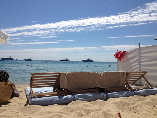 Kick back with your feet in the sand at Club 55 St Tropez
