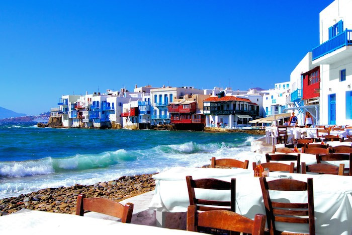 Dine on Greek specialties with your feet almost in the water!