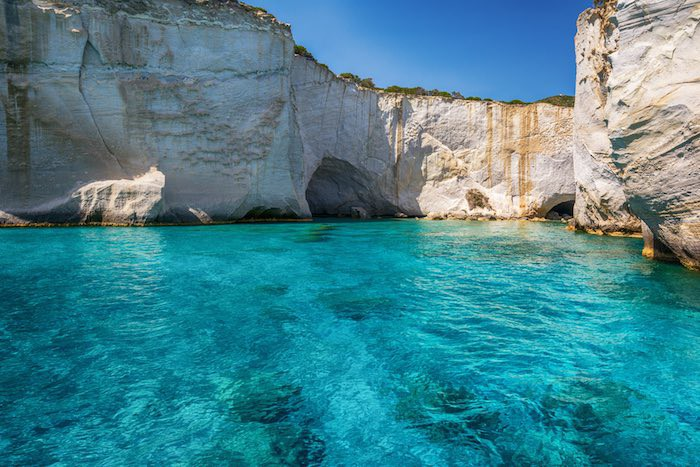 Explore the coves and inlets scattered throughout the stunning blue waters of the Greek islands