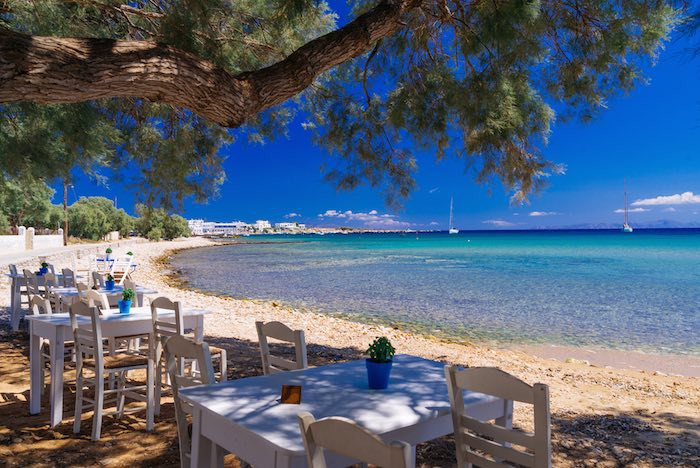 Sit back in the Greek sunshine and enjoy lunch in a typical taverna