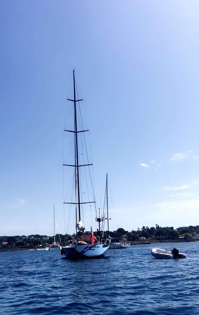Sailing yachts at anchor by the Cannes islands